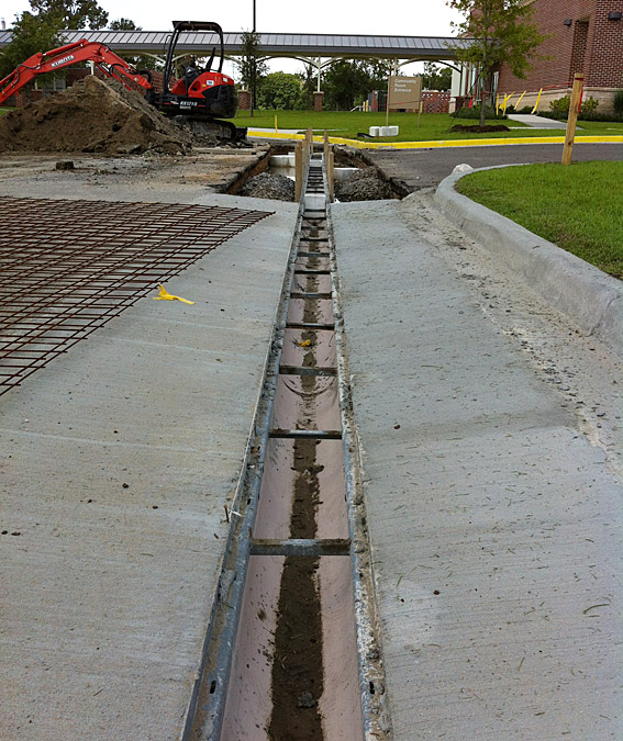 Lamar Contractors Installs Trench Drain System At St