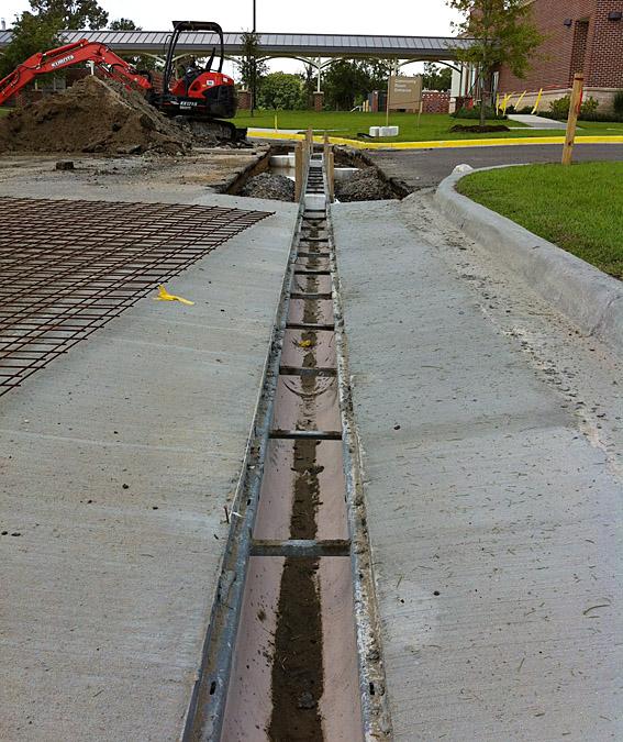 Lamar Contractors Installs Trench Drain System At St